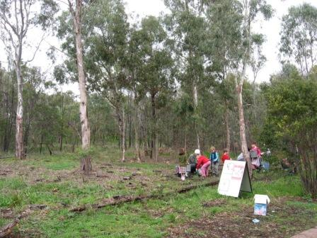 Students enjoy planting in this bush setting by the creek